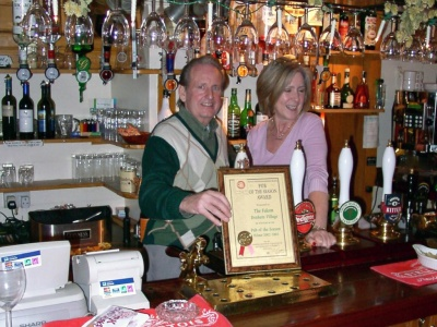 The Falcon Inn - Denham - Mine hosts receiving a Pub of the Year award